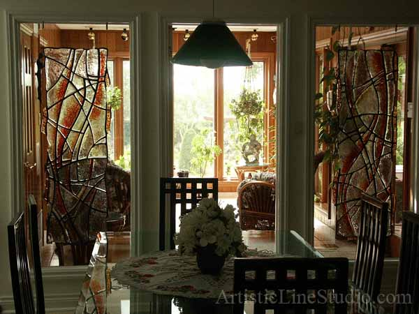 Contemporary style suspended stained, fused and leaded glass sculpture after installation